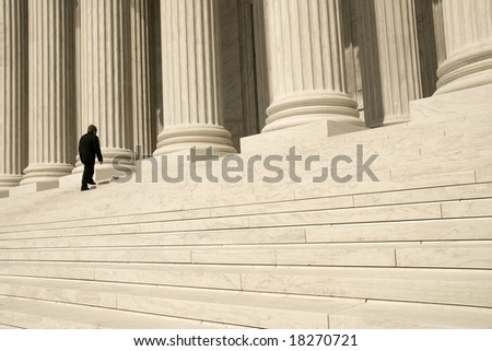 A man ascending the steps at the entrance to the US Supreme Court in Washington, DC.