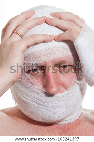 a man bandaged up with a head injury