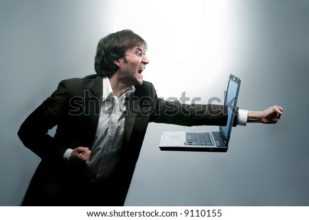 A man breaking a notebook - stock photo