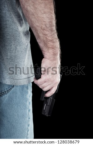 A man carries a semi automatic pistol looking for trouble.