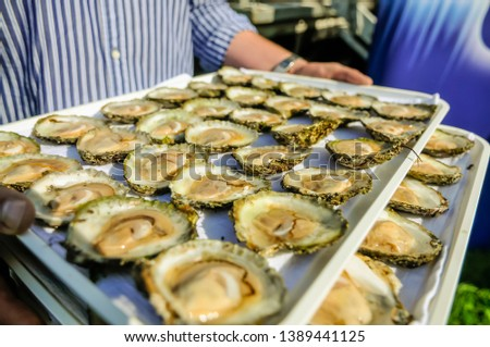 A man carries a tray of 30 Galway oysters at the International Oyster Festival.A man carries a tray of 30 Galway oysters at the International Oyster Festival. #1389441125