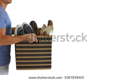 A man carries the box with many shoes inside for house moving. Photo isolated on white background with space for text. #1087838405