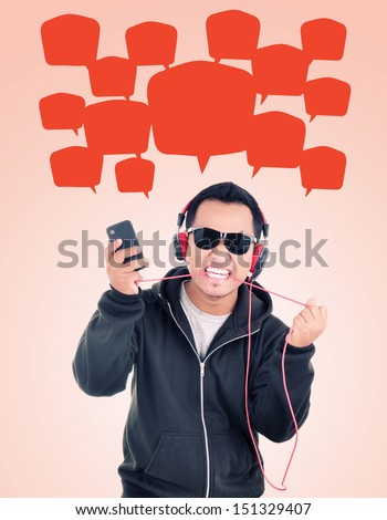 a man carrying Hand phones and biting headphones cable, isolated on white background
