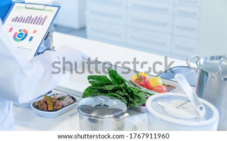 A man checking meals in the kitchen. Food management.