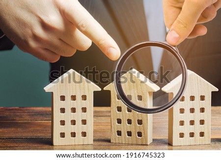 A man chooses an apartment house among many propositions options in the real estate market. Housing solution. Facilities and infrastructure. Investments. Realtor services to find suitable options. Photo stock ©