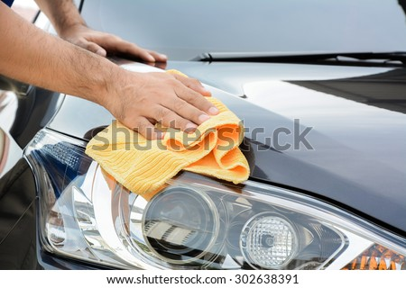 Shutterstock A man cleaning car with microfiber cloth, car detailing (or valeting) concept