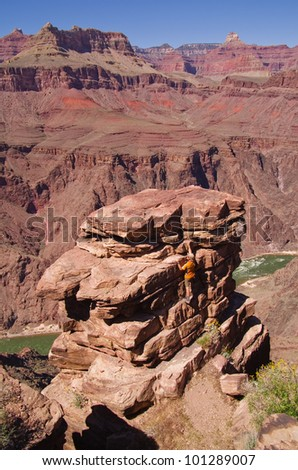 a man climbing up to an overlook at Plateau Point in the Grand Canyon