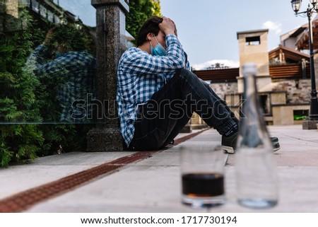 a man consumes alcohol during quarantine through dismissal