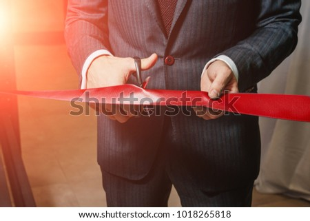 A man cutting a red ribbon, opening ceremony, isolated on white background #1018265818