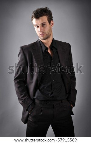 a man dressed in black business suit