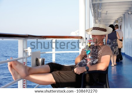 a man enjoying a cocktail in the summer on the liner