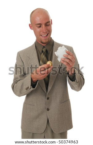 A man excited to see a golden egg come out of his piggy bank