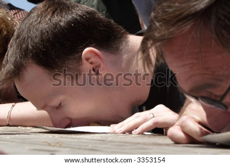 a man face down in a plate at a pie eating contest