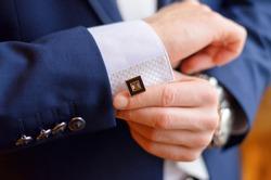 a man fastens a cuff-link on a cuff