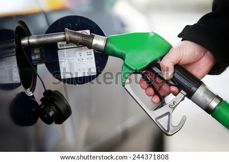 A man filling a car with petrol