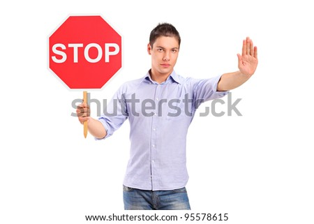 A man gesturing and holding a traffic sign stop isolated against white background - stock photo