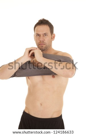 A Man Getting Ready To Put His Shirt On After Not Having