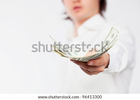 A man giving a handful of dollars.