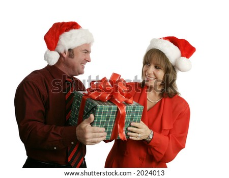 A man giving a pretty woman a Christmas gift.  Isolated on white.