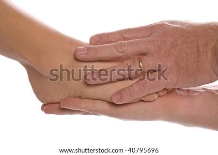stock-photo-a-man-giving-a-woman-a-foot-massage-40795696.jpg