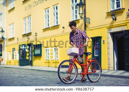 a man goes out a bakery. bicycle