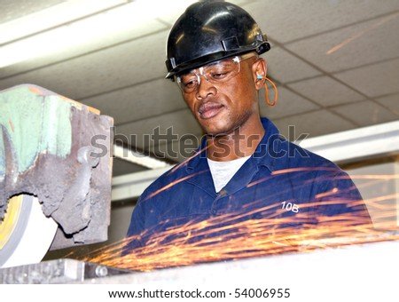A man grinding a piece of metal