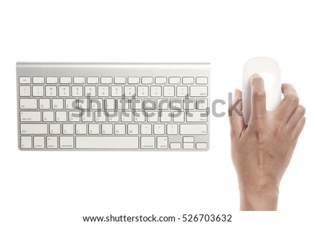 A man hand hold a wireless mouse with keyboard isolated white. #526703632