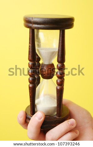 A man hand holding a hourglass