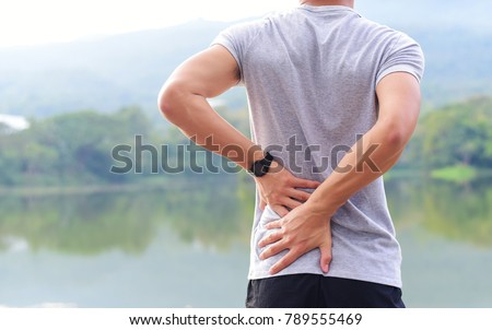 a man has low back pain #789555469