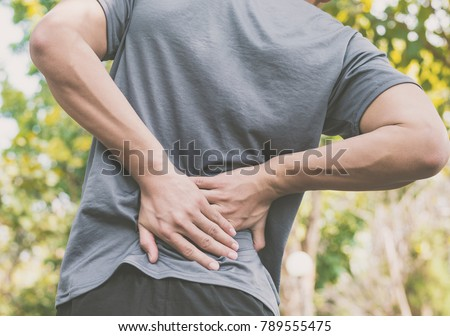 a man has low back pain