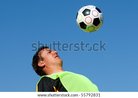 A man heading a soccer ball