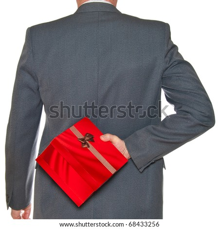 A man hides behind a box at Valentine's Day isolated on white. - stock photo
