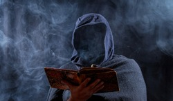 a man hides his face and reads in a book
