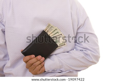 A man hiding a wallet on his back - stock photo