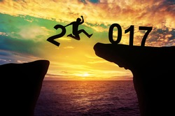 A man hold number 2 jump between hill 2017 years, success concept, Silhouette.