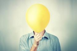 A man holding a balloon