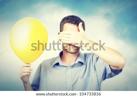 A man holding a balloon