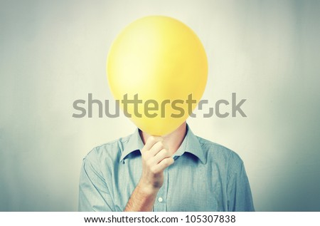 A man holding a balloon - stock photo