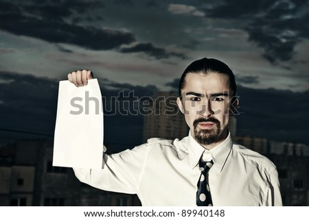 A man holding a blank white paper