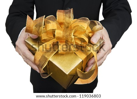 A man holding a gift box in a gesture of giving. Isolated on white.