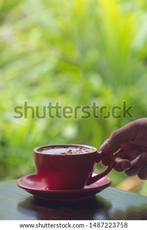 A man holding a red hot coffee cup With copy space with copy space for your text message