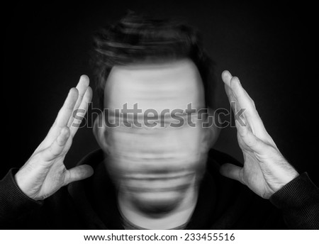A Man Holding His Head and Shaking