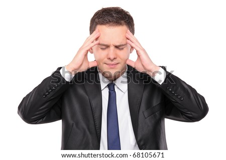 A man holding his head in pain as a result of a headache isolated on white background