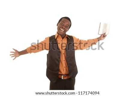 A man holding out his book with an excited expression on his face.