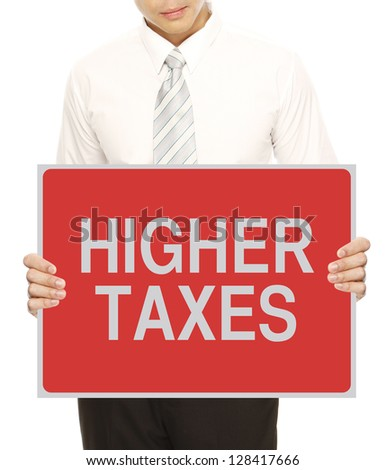 A man holding sign indicating Higher Taxes