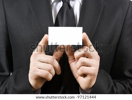 a man holds, a business card isolated on a white background