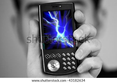 A man holds a cell phone with a lightning bolt illustration on the screen.  Great image to illustrate cell phone radiation.