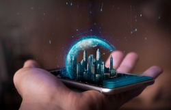 A man holds a futuristic phone in his hand, on which appears a futuristic metropolitan city with a holographic world. Concept of: business, connection, communication, people.