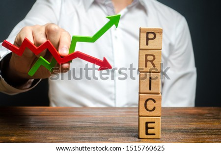 A man holds a red and green arrow and predicts a price change. Price regulator, controller. Supply-demand balance, market laws. Economics and free commerce. Planned Economy. Stock quotes movement. ストックフォト ©