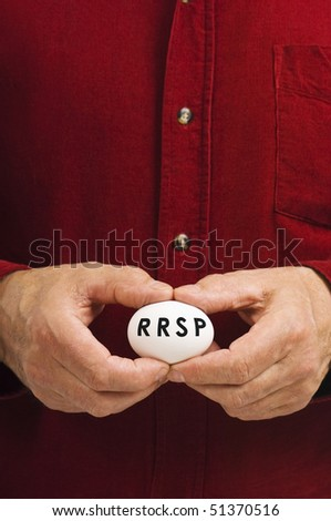 A man holds an egg with RRSP written on it.